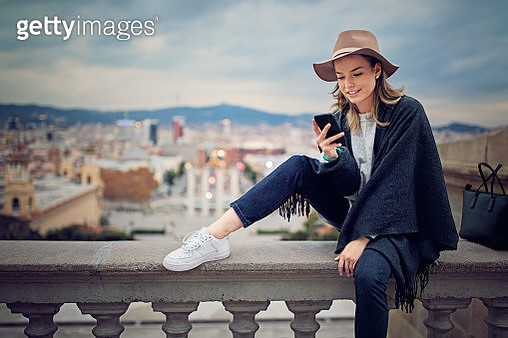 Young girl is texting using her mobile phone - gettyimageskorea