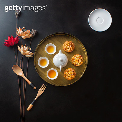 Flat lay conceptual Chinese afternoon tea with mooncake. - gettyimageskorea
