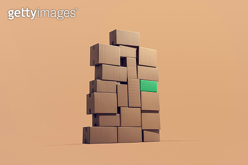 A large pile of cardboard boxes stacked on top of each other. - gettyimageskorea