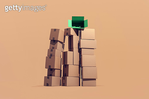 A large pile of cardboard boxes stacked on top of each other - gettyimageskorea