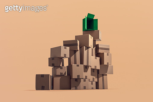 A large pile of cardboard boxes stacked on top of each other in a pattern - gettyimageskorea