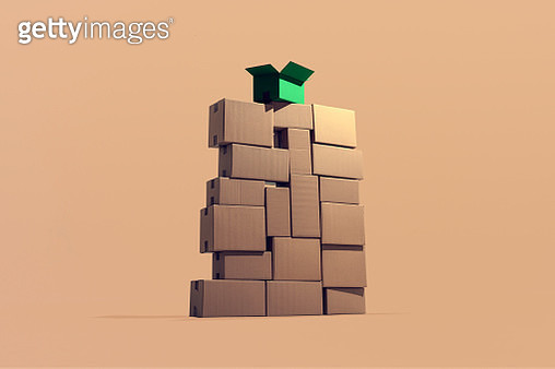 A large pile of cardboard boxes piled on top of each other where one green box stands out symbolizing sustainable cargo. - gettyimageskorea