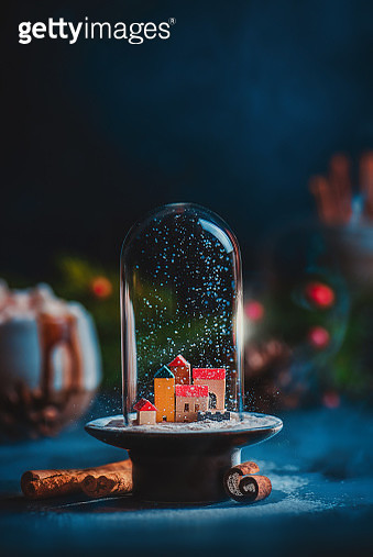 Christmas miniature town under snow in a glass dome. Creative still life with copy space - gettyimageskorea