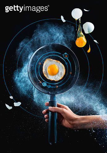 Fried egg on a skillet in a cloud of flour, galaxy breakfast concept with copy space - gettyimageskorea