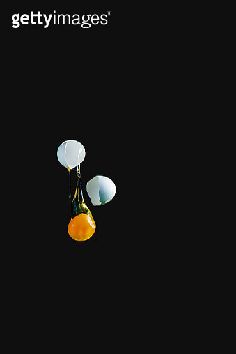 Flying yolk on black background, high-speed food photography - gettyimageskorea