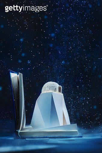 Winter scene with snow hut, igloo inside a book under the snow. Creative still life, literature concept - gettyimageskorea