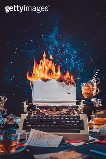 Typewriter with burning papers, a flame in the shape of a castle, fantasy writer workplace concept - gettyimageskorea