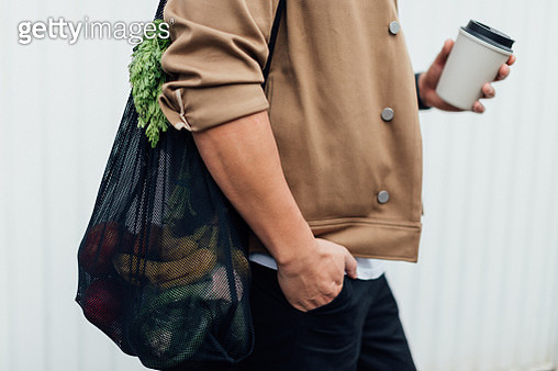 Man Going Grocery Shopping With A Reusable Shopping Bag - gettyimageskorea