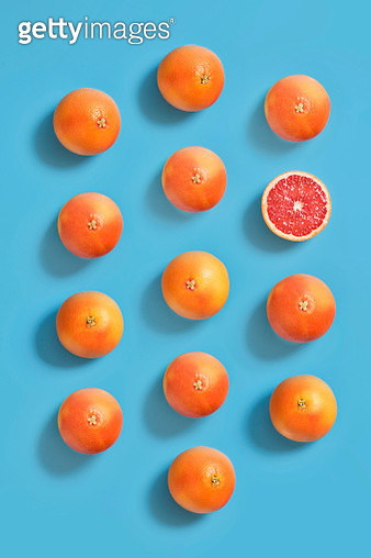 Grape fruits on blue background. - gettyimageskorea