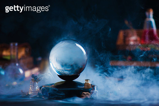 Crystal ball with occult equipment and mysterious smoke. Magical header with copy space - gettyimageskorea