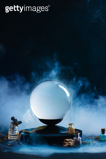 Crystal ball with occult equipment and mysterious smoke. Fortune-telling concept with copy space - gettyimageskorea
