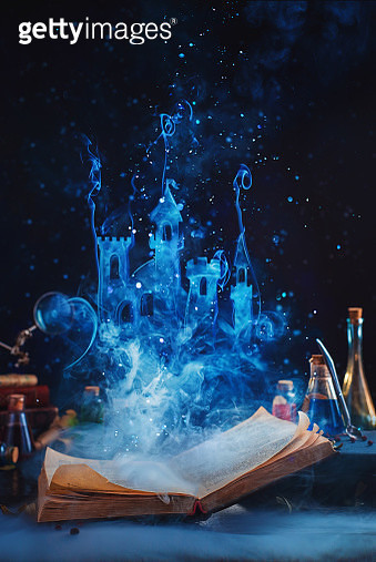 Open book with a fantasy castle made of magical smoke. Reading and imagination concept - gettyimageskorea