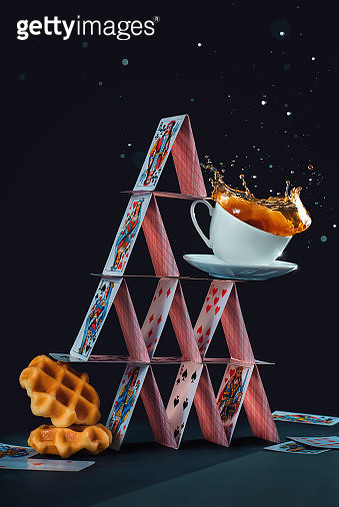 House of cards with waffles and coffee cup, balanced diet concept. Creative still life with a coffee splash - gettyimageskorea