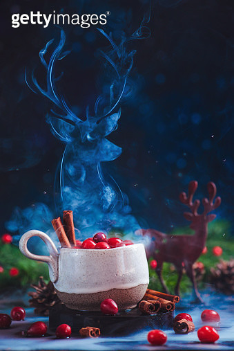 Christmas deer silhouette out of steam above a ceramic cup with berry hot drink - gettyimageskorea