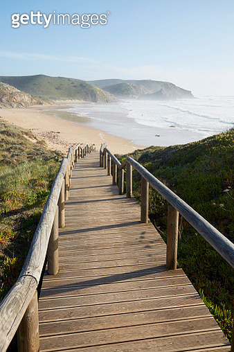 Boardwalk/stairs to the sea, atmospheric mood at the Atlantic Coast - gettyimageskorea