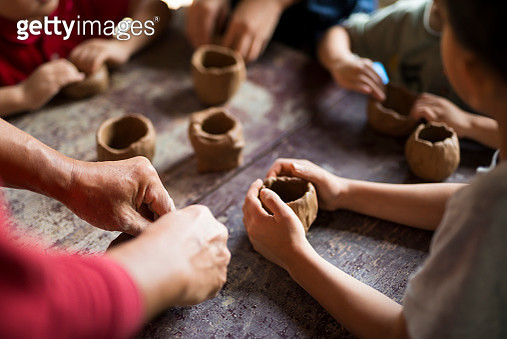 Kids making cups with pottery clay - gettyimageskorea