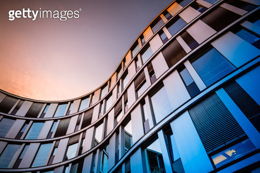 Glass facade of a modern office building in Hamburg, Germany. - gettyimageskorea