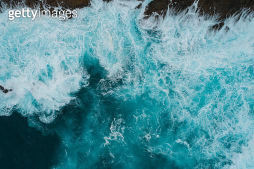 Water splashing against rocks. - gettyimageskorea