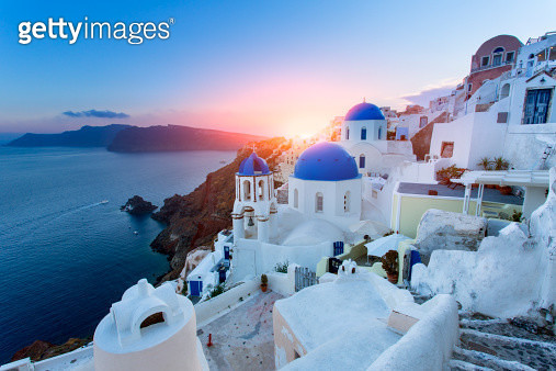 Blue domed churches at sunset, Oia, Santorini - gettyimageskorea