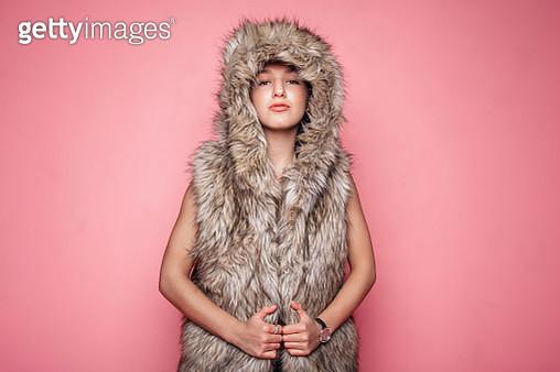 Portrait of young woman wearing fur coat - gettyimageskorea
