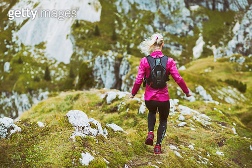Female running in the mountains - gettyimageskorea