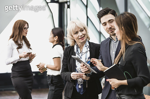 Business People Having a Meeting - gettyimageskorea
