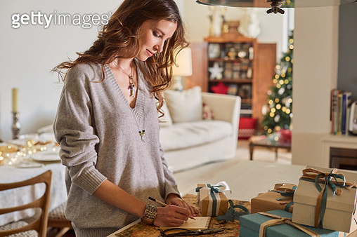 Celebrating Christmas, wrapping presents. - gettyimageskorea