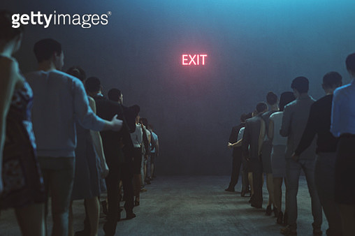 Tired people waiting in front of Exit sign - gettyimageskorea