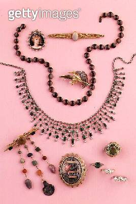 Selection of jewellery: garnet collet necklace; emerald and diamond fringe necklace; oval enamel brooch with pharaoh; pendant brooch with semi-precious gems; peridot and diamond dress ring; ruby and pearl brooch; Art Nouveau opal bar brooch; Art Nouveau e - gettyimageskorea