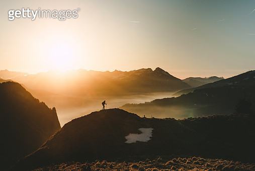 Silhouette Of Man On Mountain Against Sky - gettyimageskorea