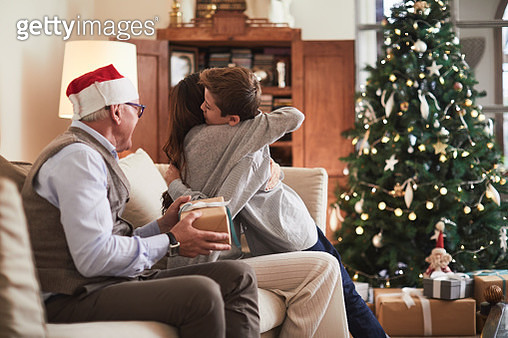 Celebrating Christmas, opening christmas presents. - gettyimageskorea