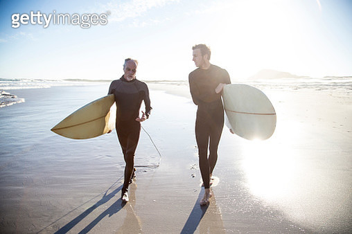 Father and son going surfing together - gettyimageskorea