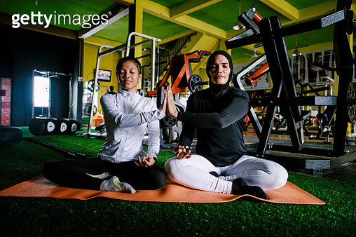 Mother and Daughter Yoga at Gym - gettyimageskorea