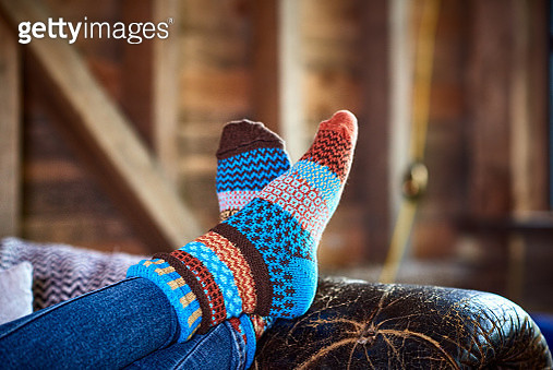 Cropped shot of legs resting on couch, funky warm socks, relaxation, comfort, security, protection - gettyimageskorea