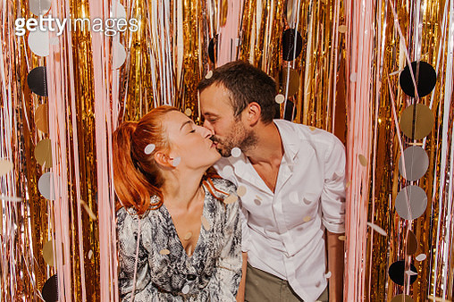 Loving couple celebrating New Year's Eve on a party - gettyimageskorea