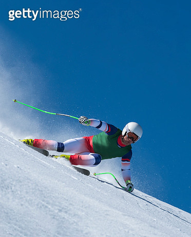 Front View of Young Male Skier at Downhill Ski Training Against the Blue Sky - gettyimageskorea