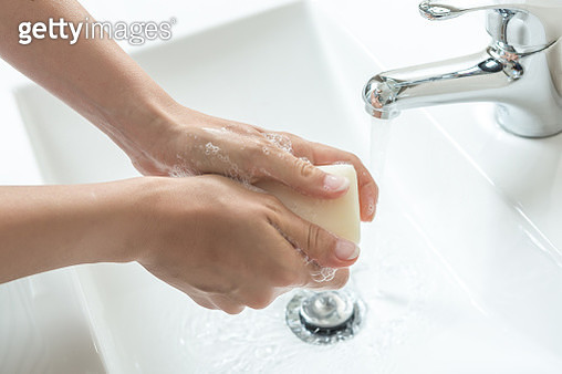 Cropped Image Of Woman Washing Hands In Sink - gettyimageskorea