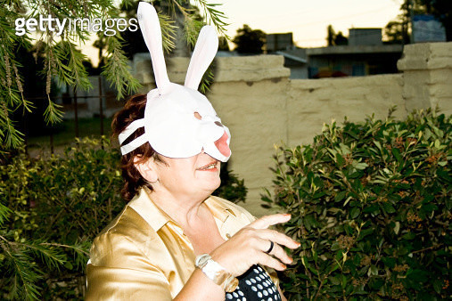 Uruguay, Montevideo, Woman with a bunny face mask - gettyimageskorea
