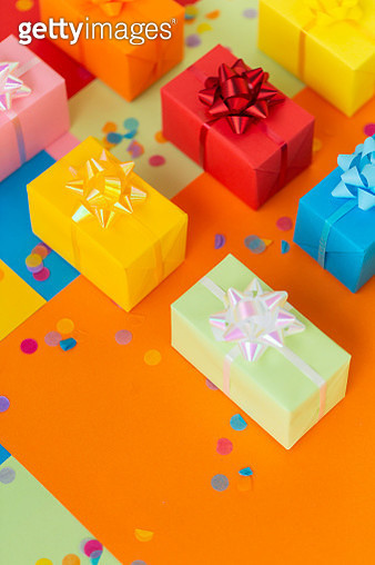 Set of multicolored present boxes on colorful background - gettyimageskorea