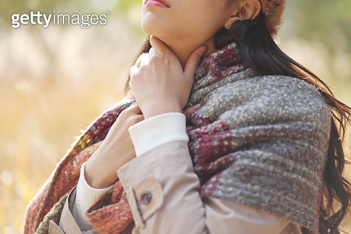Woman suffering from neck pain - gettyimageskorea