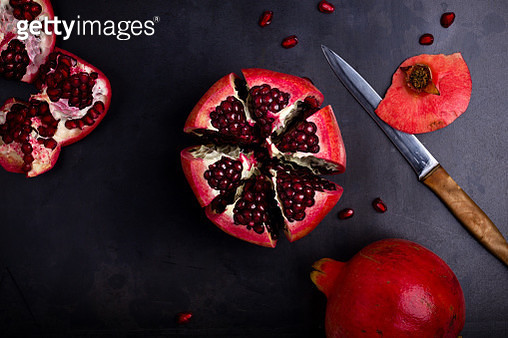 Ripe pomegranate fruit on  vintage background, top view - gettyimageskorea