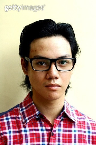 Portrait Of Young Man Wearing Eyeglasses Against Wall - gettyimageskorea