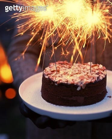 Chocolate celebration cake with flaming sparklers - gettyimageskorea