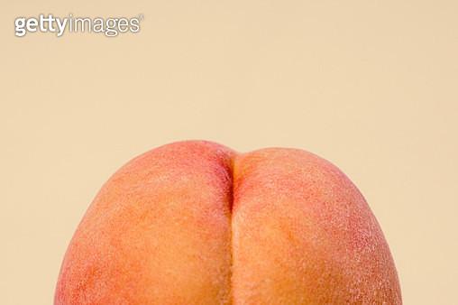 Fresh Peach on Peach Colored Background - gettyimageskorea