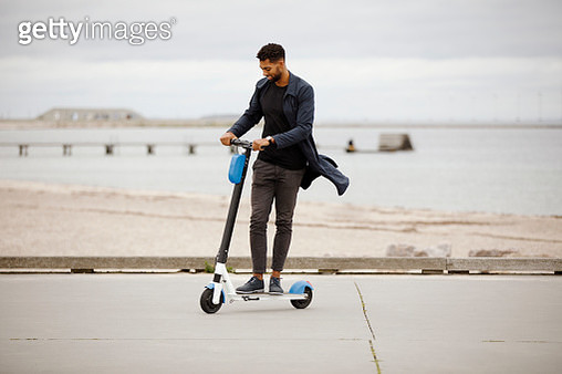young man riding electric scooter - gettyimageskorea