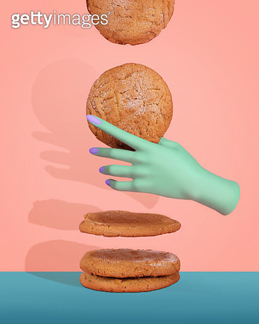 Surreal still life composition featuring a mint green mannequin hand with lavender nail polish grabbing a peanut butter cookie from a floating stack of cookies against a peach and blue background. - gettyimageskorea