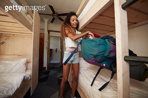 Young woman with backpack, arriving at empty hostel room - gettyimageskorea