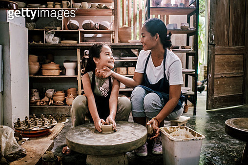 Mother Having Fun Potter Teaching The Art of Pot Making with Her Daughter - gettyimageskorea