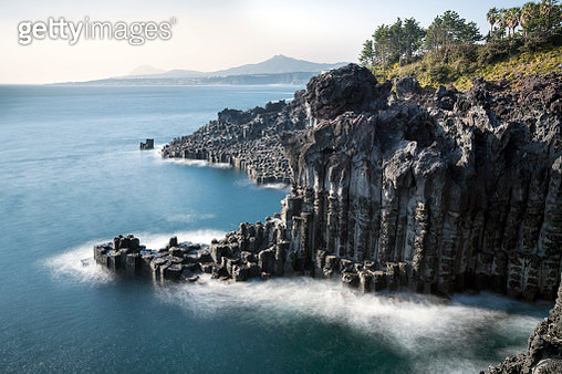 landscape of cliff and white of wave at jeju island - gettyimageskorea