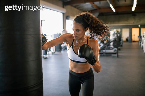 Female boxer punches sand bag - gettyimageskorea